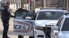 A woman is placed in a London police cruiser at 241 Simcoe Street on Wednesday, March 3, 2021. (Daryl Newcombe / CTV London)