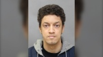 Daniel Caster, 27, of Toronto surrendered to police on Feb. 24 and was charged with sexually assaulting a 16-year-old girl in 2019. (Toronto Police)