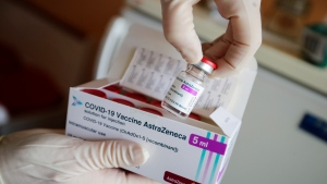 A package of the AstraZeneca COVID-19 vaccine is shown in the state of Brandenburg where the first coronavirus vaccinations are given in doctors' surgeries, in Senftenberg, Germany, Wednesday, March 3, 2021. (Hannibal Hanschke/Pool via AP)