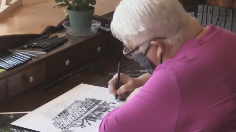 Woman capturing old barns in art to preserve them