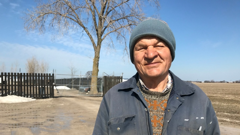 "Peter Starzacher stands in front the damaged gate into his storage lot on Cty Rd 42. It was bent backwards after a driver ""thought he could just run right through"", trying to evade police in Essex County, Ont. on Wednesday, March. 3, 2021. (Michelle Maluske/CTV Windsor)"