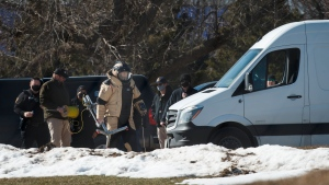 Ankeny Police investigate the scene at the Lakeside Center where a suspicious package was found on Tuesday, March 2, 2021, in Ankeny, Iowa. Technicians safely detonated the device, and the center was reopened. Police later confirmed that the device was a pipe bomb. (Brian Powers/The Des Moines Register via AP)
