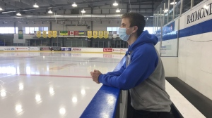 Zach Cain, a forward for the Melville Millionaires, stands on the bench at Horizon Credit Union Centre. (Stefanie Davis/CTV News)