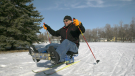 Scott Glass enjoys Nordic skiing on a sit ski, loaned out by the Saskatchewan Ski Association (Claire Hanna / CTV Regina)