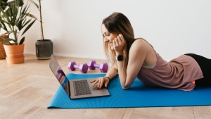 A woman about to start an at-home workout is seen in this file image. (Pexels)