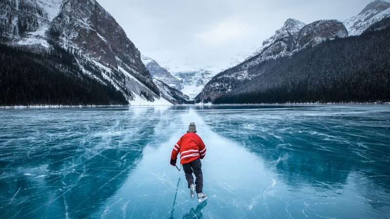 A skater on Lake Louise in Banff National Park. (Courtesy: Paul Zizka Photo)