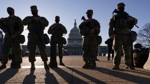"Members of the Michigan National Guard and the U.S. Capitol Police keep watch as heightened security remains in effect around the Capitol grounds since the Jan. 6 attacks by a mob of supporters of then-President Donald Trump, in Washington, Wednesday, March 3, 2021. The U.S. Capitol Police say they have intelligence showing there is a ""possible plot"" by a militia group to breach the Capitol on Thursday. (AP Photo/J. Scott Applewhite)"