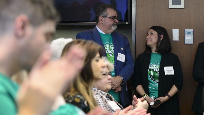 Toby and Bernadine Boulet look at one another as they are recognized during an event for Green Shirt Day and National Organ and Tissue Donation Awareness Week in Ottawa on Wednesday, April 3, 2019. (THE CANADIAN PRESS/Sean Kilpatrick)