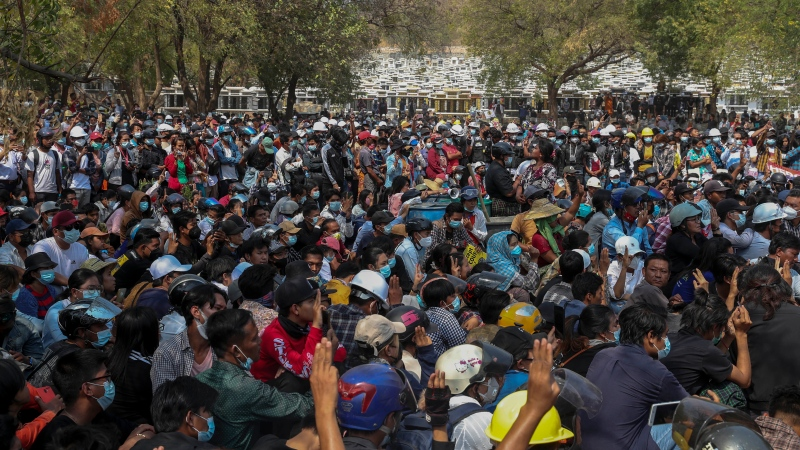 Hundreds of people gather for the burial of Kyal Sin in Mandalay, Myanmar, Thursday, March 4, 2021. Kyal Sin was shot in the head by Myanmar security forces during an anti-coup protest rally she was attending Wednesday. (AP Photo)