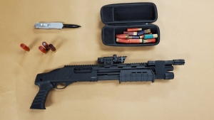 Items seized by London police including a shotgun.