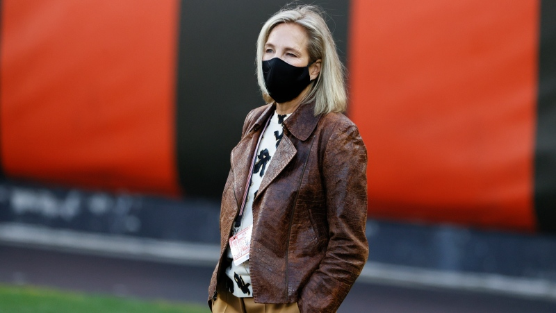 "In this Sept. 17, 2020, file photo, Cleveland Browns co-owner Dee Haslam walks the field before the team's NFL football game against the Cincinnati Bengals in Cleveland. ""We're seeing more and more women that love the sport and who want a career in sports,"" Haslam said last month. ""The door has swung wide open and I am so excited. I look forward to the moment when we don't have to talk about how we get the door open for women and people of color, that the door is wide open."" (AP Photo/Ron Schwane, File)"