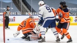 Edmonton Oilers goalie Mikko Koskinen (19) is scored on as Toronto Maple Leafs Joe Thornton (97) and Ethan Bear (74) battle in front during first period NHL action in Edmonton on Monday, March 1, 2021.THE CANADIAN PRESS/Jason Franson