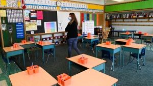 Grade 2 teacher Vivian Mavraidis walks through her classroom at Hunter's Glen Junior Public School during the COVID-19 pandemic in Toronto, on Monday, September 14, 2020. (THE CANADIAN PRESS / Nathan Denette)