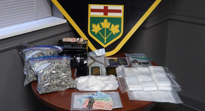 Drugs and cash seized from a residence in Plympton-Wyoming, Ont. on March 3, 2021 are seen in this image from OPP.