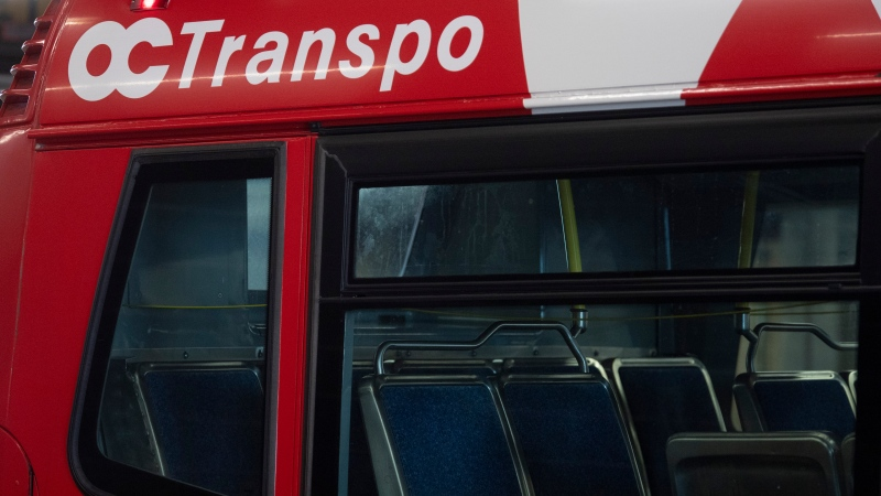 An OC Transpo bus is seen at a public transit garage in Ottawa, Thursday March 4, 2021. (Adrian Wyld/THE CANADIAN PRESS)