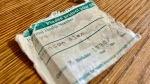 Alberta's paper health care ID cards are notoriously prone to ripping and crumpling (CTV News)