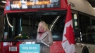 Infrastructure and Communities Minister Catherine McKenna speaks during an announcement at a public transit garage in Ottawa, Thursday March 4, 2021. THE CANADIAN PRESS/Adrian Wyld