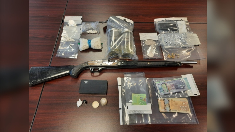 Police say they seized quantities of what is believed to be methamphetamine, an unsecured loaded firearm and money. (Photo courtesy: RCMP)