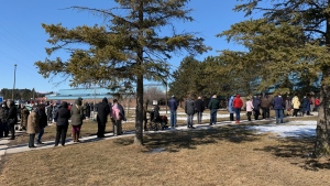 People are shown lining up for their COVID-19 vaccination appointments outside the Ray Twinney Recreation Complex in Newmarket on Thursday. (submitted)