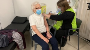 Health-care workers give a COVID-19 vaccination on March 4, 2021 (Supplied: Region of Waterloo)