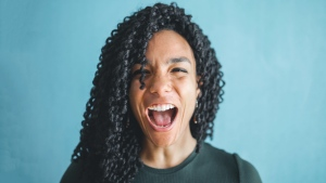 A woman is seen screaming in this stock photo. (Andrea Piacquadio/Pexels)