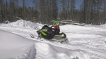 Three year old girl in Timmins enjoys snowmobiling