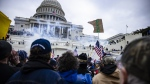 Federal investigators are examining records of communications between members of Congress and the pro-Trump mob that attacked the U.S. Capitol. Rioters are shown here at the U.S. Capitol following a rally with President Donald Trump on January 6, 2021 in Washington, DC. (Samuel Corum/Getty Images/CNN)