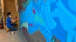 A mural showcasing the emotions around COVID-19 is nearing completion. (Brandon Lynch/CTV News Edmonton)