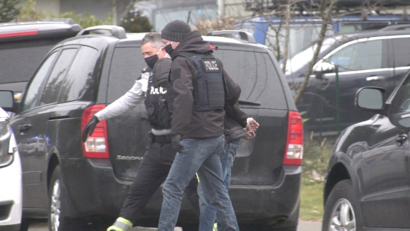 A man is seen being arrested at the property on March 4: (CTV News)