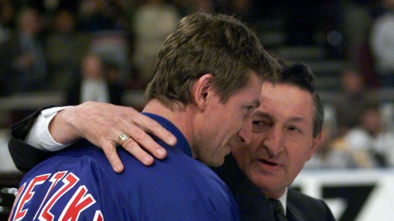 New York Rangers Wayne Gretzky is hugged by his father Walter after being presented with a car during the pre-game ceremonies for Gretzky's last game in the NHL Sunday, April 18, 1999, in New York. (CP PHOTO/Paul Chiasson)