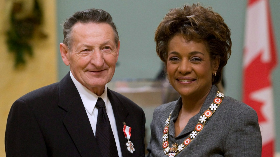 Walter Gretzky poses with Governor General Michaelle Jean after being invested as Member to the Order of Canada at a ceremony in Ottawa, Friday Dec.12, 2008. (THE CANADIAN PRESS/Adrian Wyld)