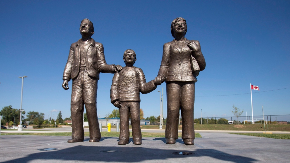 A statue of Wayne Gretzky and his parents Walter and Phyllis stands in front of the Wayne Gretzky Sports Centre in Gretzky's hometown of Brantford, Ont., Wednesday, October 2, 2013. (THE CANADIAN PRESS/ Geoff Robins)