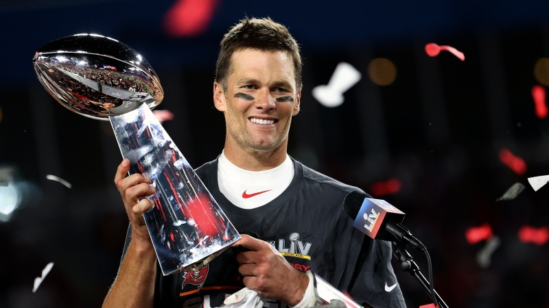 Tampa Bay Buccaneers quarterback Tom Brady holds the Vince Lombardi trophy following the NFL Super Bowl 55 football game against the Kansas City Chiefs, Sunday, Feb. 7, 2021, in Tampa, Fla. (Ben Liebenberg via AP)