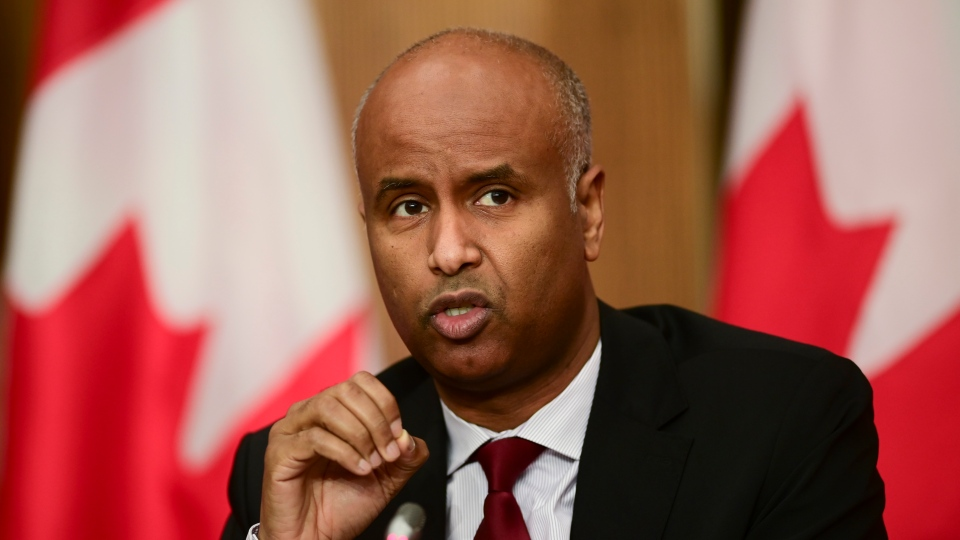 Minister of Families, Children and Social Development Ahmed Hussen takes part in an update on the COVID pandemic during a press conference in Ottawa on Tuesday, Oct. 27, 2020. (THE CANADIAN PRESS/Sean Kilpatrick)