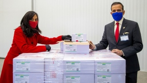 Anita Anand, Canada's Minister of Public Services and Procurement and the High Commissioner of India to Canada Ajay Bisaria pose with some of the first 500,000 of the two million AstraZeneca COVID-19 vaccine doses that Canada has secured through a deal with the Serum Institute of India in partnership with Verity Pharma at a facility in Milton, Ont., on March 3, 2021. (Carlos Osorio / THE CANADIAN PRESS)