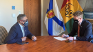 Nova Scotia Premier Iain Rankin and Minister of African Nova Scotian Affairs Tony Ince discussing the Land Titles Initiative (Photo via Communications Nova Scotia)
