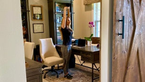 Create a habit of getting out of your chair every hour for a few minutes of movement. Stretches relieve stiffness and mitigate the negative health impacts caused by sitting all day long. (Dana Santas/CNN)