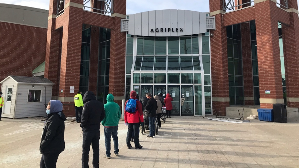 Those waiting for their appointment to receive the COVID-19 vaccine lineup outside the Western Fair District Agriplex in London, Ont. on Friday, March 5, 2021. (Sean Irvine / CTV News)