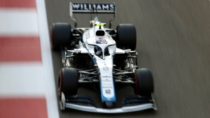 Williams driver Nicholas Latifi of Canada in action during the warm up lap of the Formula One race at the Yas Marina racetrack in Abu Dhabi, United Arab Emirates, Sunday, Dec.13, 2020. (Hamad Mohammed, Pool via AP)
