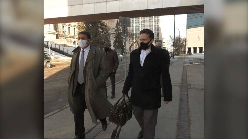 Manuel Ruiz (left) leaves the Law Courts building Friday Mar. 5, 2021 with his lawyer Matt Gould (right) and supporters. (CTV News Photo Josh Crabb)