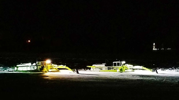 The amphibex last night on the Red River at 3am. Photo by Karen Fey.