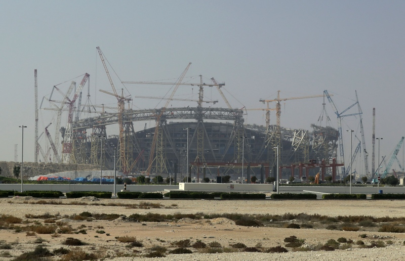 In this file photo dated Friday, Dec. 20, 2019, construction underway at the Lusail Stadium, one of the 2022 World Cup stadiums, in Lusail, Qatar. Qatar has expressed an interest in hosting the 2032 Olympic and Paralympic Games. (AP Photo/Hassan Ammar, FILE)
