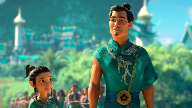 "Animated character young Raya, left, appears with her father Benja, voiced by Daniel Dae Kim in a scene from ""Raya and the Last Dragon."" (Disney+ via AP)"