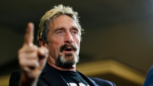 In this Sept. 9, 2015, file photo, internet security pioneer John McAfee announces his candidacy for president in Opelika, Ala.  (Todd J. Van Emst/Opelika-Auburn News via AP, File)