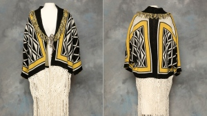 This combination of photos provided by the Sealaska Hertiage Institute in Juneau, Alaska, shows the front and back of a Tlingit Ravenstail coat. An Alaska Indigenous cultural organization and the luxury department store Neiman Marcus have settled a lawsuit over the sale of a coat with a copyrighted, geometric design borrowed from indigenous culture. (Brian Wallace/Sealaska Heritage Institute via AP)