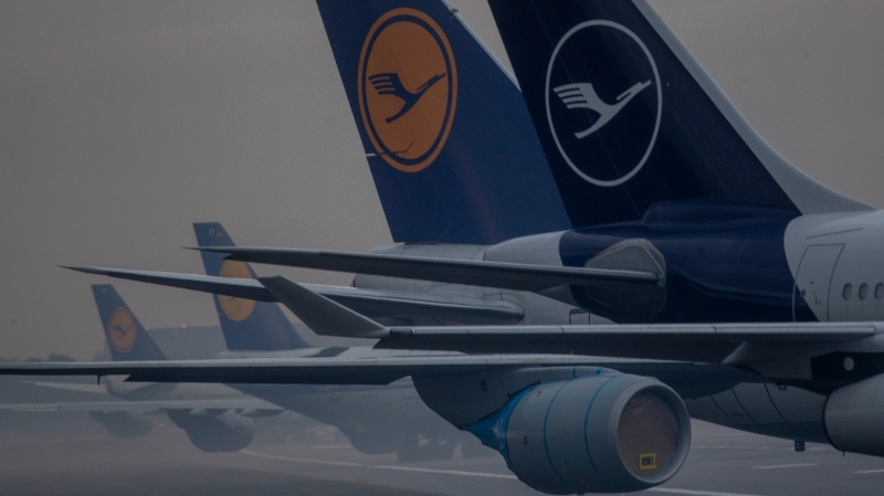 Lufthansa aircrafts that are not in use at the moment are parked on a closed runway in Frankfurt, Germany, Thursday, Dec. 17, 2020. (AP Photo/Michael Probst)