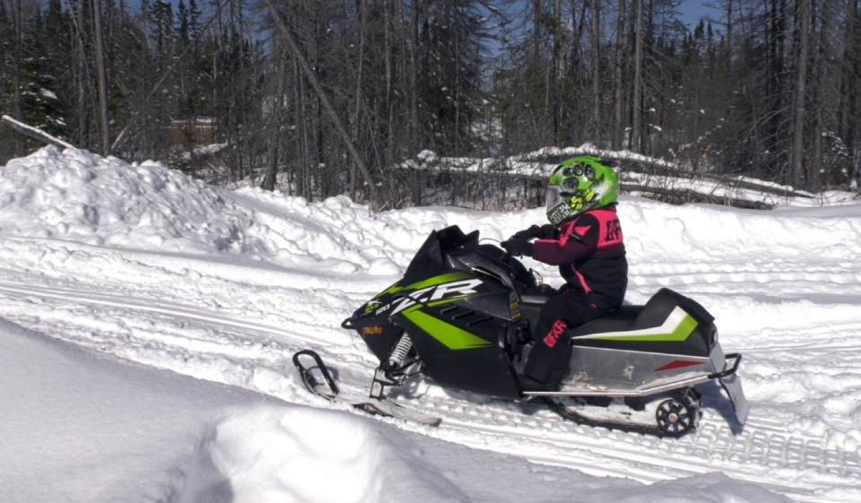 Three-year old Hannah Roy is like many northerners who loves driving a snow machine. Her parents bought her a sled when she was just 18-months old and next year, she hopes to enter snowcross racing events. (Lydia Chubak/CTV News)