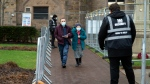 Members of the public arrive at Blackburn Cathedral, which is being used as a mass vaccination center during the coronavirus outbreak in Blackburn, England, Monday Jan. 18, 2021. The first 24-hour vaccination centers will be piloted in London before the end of January, the UK's vaccines minister Nadhim Zahawi has said. ( AP Photo Jon Super)