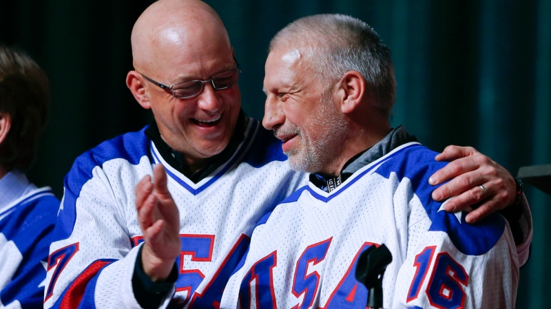 "In this Feb. 21, 2015, file photo, Jack O'Callahan, left, and Mark Pavelich of the 1980 U.S. ice hockey team talk during a ""Relive the Miracle"" reunion at Herb Brooks Arena in Lake Placid, N.Y. Pavelich has died at a treatment center for mental illness. The cause and manner of death are still pending. (AP Photo/Mike Groll, File)"