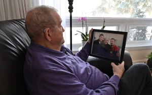 Charles Henry looks at photo of him with Wayne and Walter Gretzky (Joel Haslam/CTV News Ottawa)